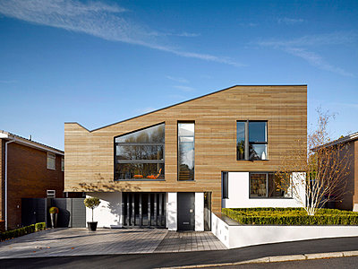 Timber cladding and driveway of building exterior of private house in Worsley, Salford, Greater Manchester, England, UK. - p8552390 by Daniel Hopkinson