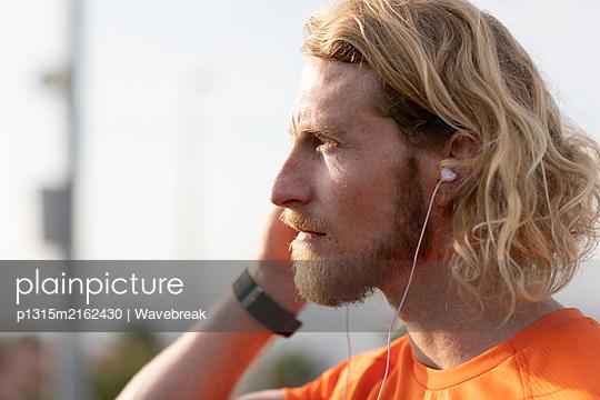 Man exercising on a footbridge - p1315m2162430 by Wavebreak