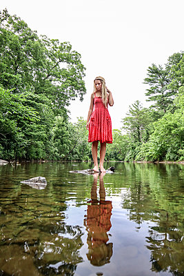 Girl In Red Dress in Stream - p1019m2100440 by Stephen Carroll
