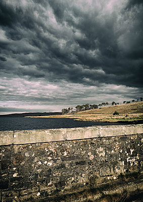 Lake landscape dramatic stone wall old clouds - p609m1219729 by OSKARQ