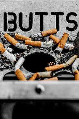 Used cigarettes in public ashtray - p1280m2044198 by Dave Wall