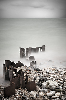Rusty wave-breakers in the fog - p1137m1154992 by Yann Grancher