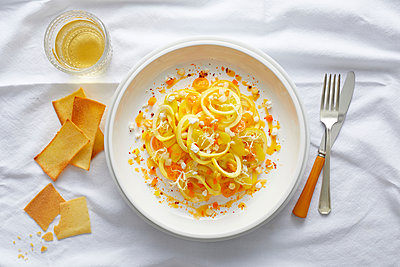 Spiralized yellow squash pasta with yellow cherry tomato, feta, orange pepper and a orange pepper coulis - p924m1494909 by Ryan Benyi Photography