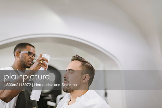 Customer in a barber shop - p300m2113972 by Hernandez and Sorokina