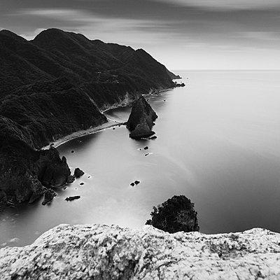 Long exposure shot of sea stacks and coastline in Izu Peninsula - p1166m2246704 by Cavan Images