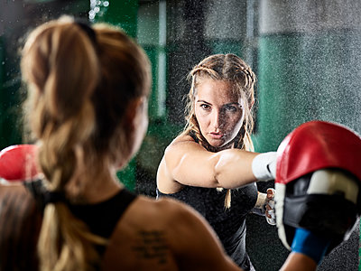 Two women having martial arts training - p300m1549765 by Christian Vorhofer