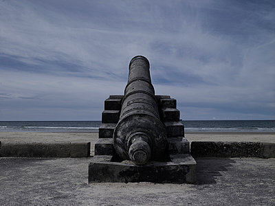 An old canon points to the seaside. Phan Thiet, Vietnam, Asia. - p934m893148 by Boris Zuliani