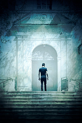 Man Standing on Church Doorway Landing  - p1248m2076340 by miguel sobreira