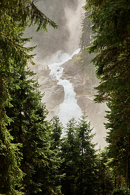 Waterfall in the mountains, fir trees in the foreground - p1511m2223022 by artwall