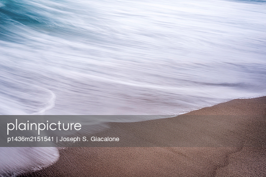 Close-up of surf meeting beach. - p1436m2151541 by Joseph S. Giacalone