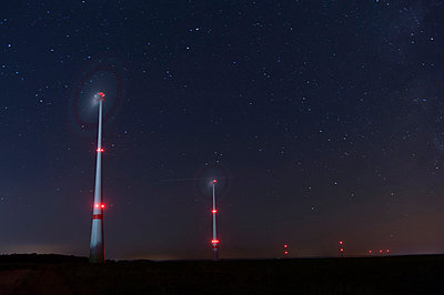 Wind turbines at night - p1079m891436 by Ulrich Mertens