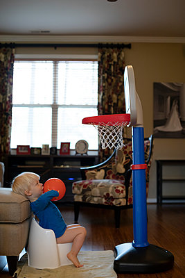 Portrait of a young boy playing basketball while potty training - p1480m2148162 by Brian W. Downs