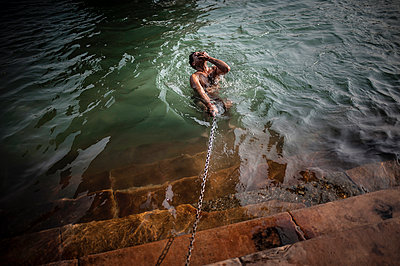 Man bathing in Ganges - p1007m1144350 by Tilby Vattard