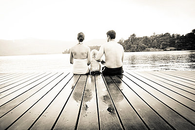 Sitting on the bathing jetty - p1086m854281 by Carrie Marie Burr