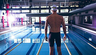 Swimmer in a swimming stadium - p1315m2118084 by Wavebreak