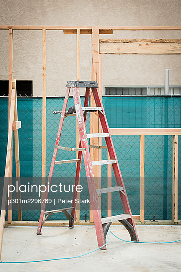Ladder and construction frame at construction site - p301m2296789 by Peter Stark