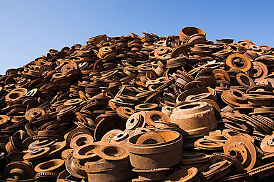 Stack of rusting metal - p9243808f by Image Source