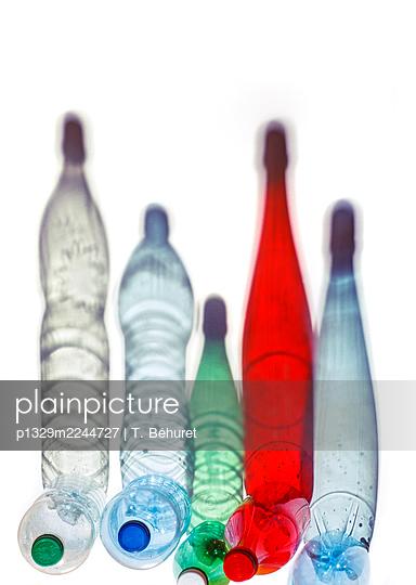 Plastic bottles and shadows - p1329m2244727 by T. Béhuret