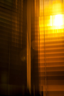 Exterior Light Through Blurred Blinds  - p1248m1492065 by miguel sobreira