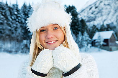 Portrait of teenage girl in white winter clothing - p31227151f by 62° Nord
