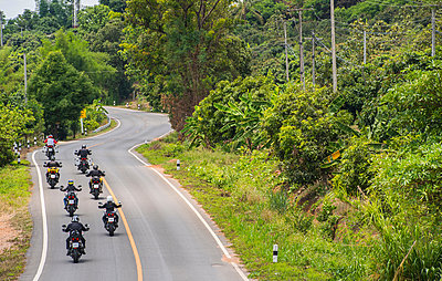 Group of biker friends on adventure motorcycle ride, Nan, Thailand - p429m2019204 by Henn Photography
