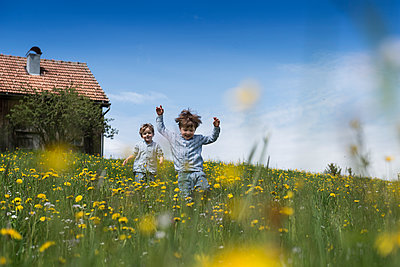 Children playing on a meadow - p282m953199 by Holger Salach