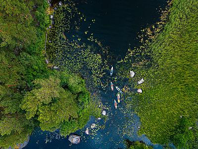 Aerial view ofpaddleboarderson bank ofVuoksi river - p300m2206822 by Konstantin Trubavin