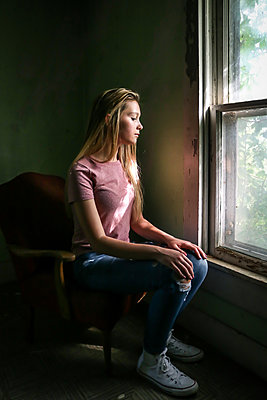 Female teenager at the window - p1019m2089423 by Stephen Carroll