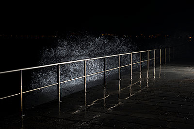 Night time waves lit with strobe lighting - p1201m1463385 by Paul Abbitt
