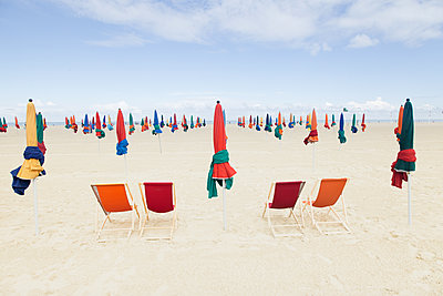 Parasols and chairs - p1333m1510641 by Gérard Staron