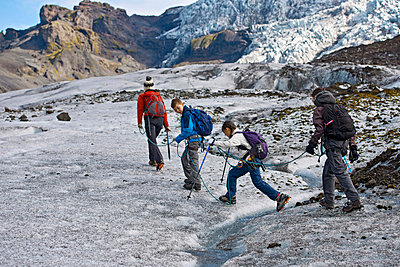 Family walking on glacier - p429m726994f by Henn Photography