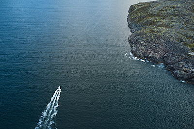Aerial view of sea with boat and rocks - p1630m2215504 by Sergey Mironov