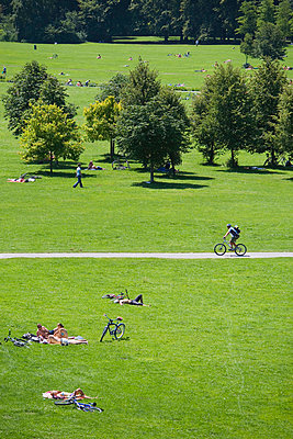 Sunbathers and cyclist in English Garden Munich Germany - p6090047f by PICK photography