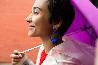 Profile portrait confident young woman with colorful accessories - p1192m2123444 by Hero Images