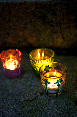 Three tea light holders and candlelight - p349m790851 by Polly Eltes