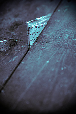 Old Letter In Crack of Floorboards  - p1248m2109271 by miguel sobreira