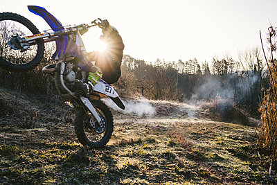 Motocross driver riding on circuit doing a wheelie - p300m2103360 by Francesco Buttitta