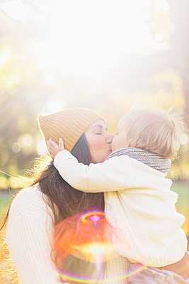 Mother kissing son in Sweden - p352m1536615 by Calle Artmark