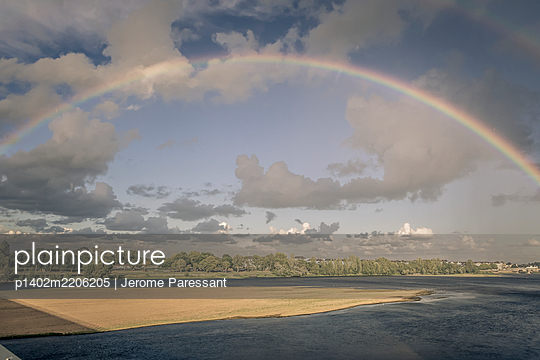 Rainbow over Saumur, France - p1402m2206205 by Jerome Paressant