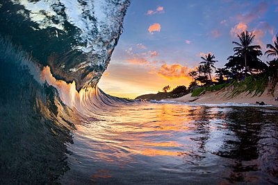 View inside breaking wave at dawn at Sunset Beach, north shore of Oahu, Hawaii Islands, USA - p343m1543703 by Sean Davey