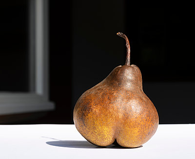 Pear in morning sun - p429m2019575 by Mischa Keijser
