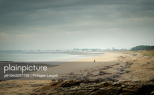 France, Kervoyal, Person on the beach - p910m2237732 by Philippe Lesprit