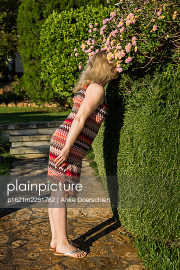 Woman in the garden - p1621m2291762 by Anke Doerschlen