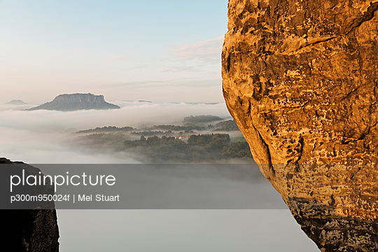 Germany, Saxony, morning mist at Elbe Sandstone Mountains - p300m950024f by Mel Stuart