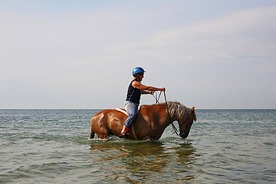 Woman on Horse in Water - p694m756970 by Ron Purdy