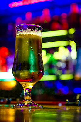 Glass of beer on counter of a bar - p300m1140860 by Andrés Benitez