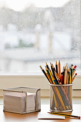 Workplace with pencils and notepad - p300m926554f by Melanie Kintz