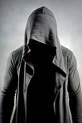 Anonymous man wearing hooded jacket - p1248m1332499 by miguel sobreira