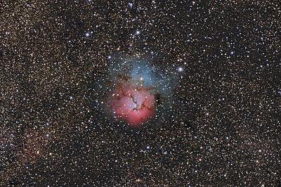Namibia, Region Khomas, near Uhlenhorst, Astrophoto of emission and reflection nebula Messier 20 or Trifid Nebula with a telescope - p300m1505919 by Thomas Grohmann