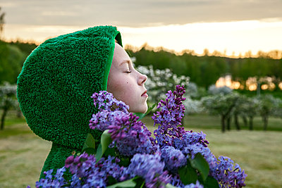 Girl with lilac flowers - p312m2080456 by Sara Winsnes